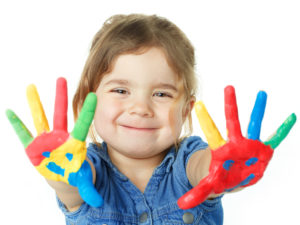 preschool child playing with paint